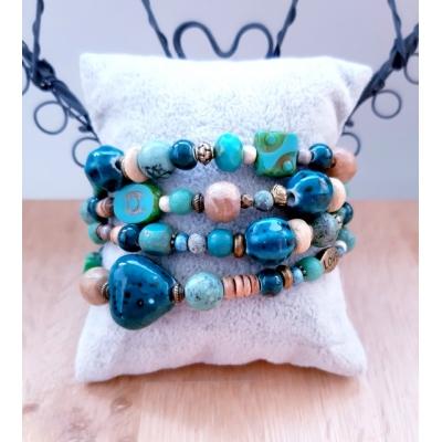 kralenarmband in blauwgroen, turquoise en brons