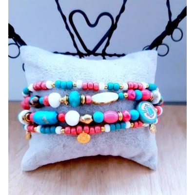 kralenarmband in roze/ turquoise/ wit en goud